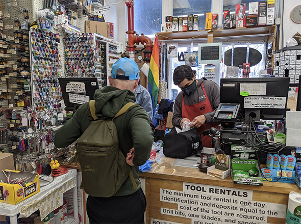 store cashiers wearing masks, but business as usual otherwise