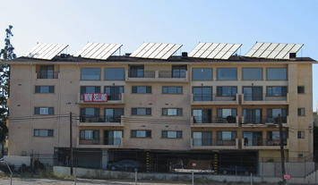 1200px-Building_with_solar_panels.jpg