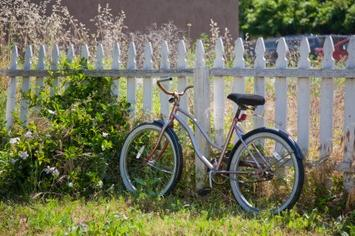 bicycle on picket fence - iStock_000010242185XSmall.jpg