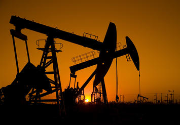 bigstock-Silhouette-of-oil-rigs-with-su-29395682.jpg