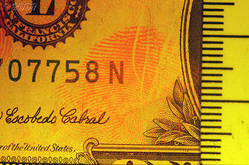 flourescent US dollar bill-1376867166_b39fe16c76.jpg