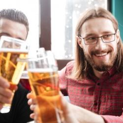 graphicstock-picture-of-young-happy-friends-sitting-in-cafe-while-drinking-alcohol-looking-at-each-other_ry54qOA6x.jpg