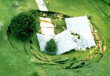 house in sinkhole improved.JPG