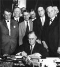 Roosevelt_signing_TVA_Act_(1933).jpg