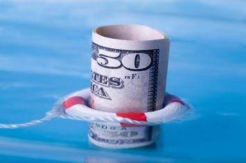 Dollar floating with lifepreserver-iStock_000008977090XSmall.jpg