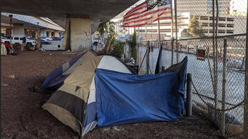 Homeless_tents_and_flag_under_CA-87_in_San_Jose.jpg