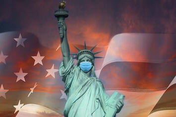 Lady_Liberty_under_a_cloudy-sunset.jpg