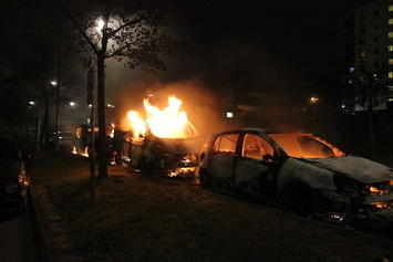 Second_day_of_Husby_riots,_three_burning_cars.jpg
