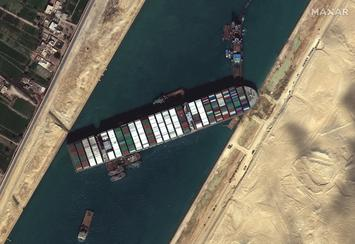 Suez_Canal_blocked_by_Ever_Given_March_27_2021.jpg