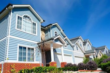 bigstock_Row_Of_Bright_New_Family_Homes_23798654.jpg